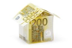 Two Hundred Euro Cottage. Small house built of several two hundred euro bills. Isolated on white background Royalty Free Stock Images