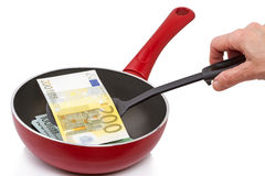 Two hundred euro on a frying pan. Isolated on white background Stock Photo
