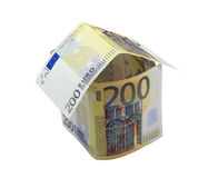 Two hundred euro house. House made from two hundred euro banknotes over white Royalty Free Stock Photos