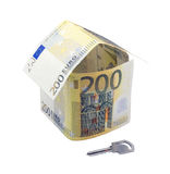 Two hundred euro house and a key. House made from 200 euro banknotes and a key isolated on a white background Royalty Free Stock Photo