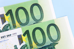 Two hundred euro. Two 100 euro notes on light blue background Stock Photography