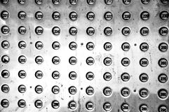 Two Hundred Something. A high contrast image of a group of buttons numbered in the two hundreds Stock Illustration