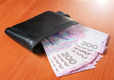 Two hundred Ukrainian hryvnia banknotes in black purse Royalty Free Stock Images