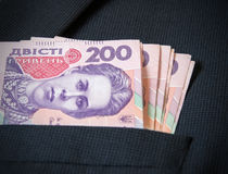 Two hundred Ukrainian hryvnia in your pocket men's jacket.  royalty free stock photo