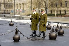 Two Hungarian soldiers of the guard of honor on the square near the Parliament during the service. March 2018 stock photo