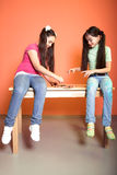 Two hungry girls with pizza Royalty Free Stock Image