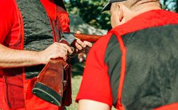 Two hunters special clothing consider shotgun stock photos