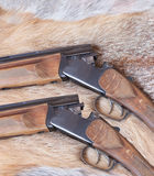 Two hunting smooth-bore gun. Lies on Fox skin royalty free stock images