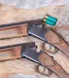 Two hunting smooth-bore gun. Lies on Fox skin stock image