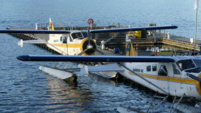 Two hydro planes on water. Aquaplane station Vancouver Canada sunny day stock video