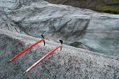 Two ice axes stuck in the ice in Skaftafell glaciar, Vatnajokull National Park in Iceland royalty free stock photos