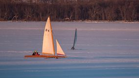 Two Ice Boats Sailing on Lake Pepin royalty free stock images