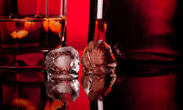 Two ice cube and whiskey Stock Photos
