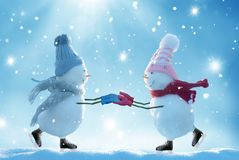 Two ice skating  snowmen. Merry christmas and happy new year greeting card .Two ice skating  snowmen Stock Image
