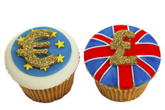 Two iced currency cupcakes. Stock Photography