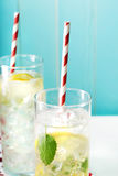 Two iced lemonades with big red striped straws Stock Photo