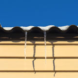 Two icicles hanging from the roof Royalty Free Stock Photography
