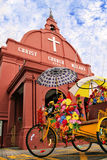 Two icons of Malacca, Malaysia. The trishaw or beca and Christ Church are two icons of Malacca, a UNESCO World Heritage Site Royalty Free Stock Images