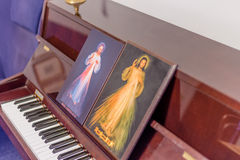 The two icons of the Merciful Jesus. On a piano as if they were musical scores: the Italian sentence on the bottoms means Jesus, I Trust in you Royalty Free Stock Photo