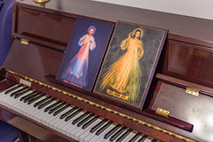 The two icons of the Merciful Jesus. On a piano as if they were musical scores: the Italian sentence on the bottoms means Jesus, I Trust in you Royalty Free Stock Image
