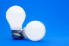 Two illuminated lightbulbs Stock Photography