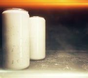 Two illuminated soda cans Royalty Free Stock Photo
