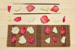 Two incense sticks and candle with bamboo bat Royalty Free Stock Images