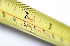 Two inches. Metal rule with point of focus at two inches stock image
