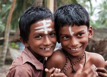 Two Indian boys on the street in fishing village Royalty Free Stock Images