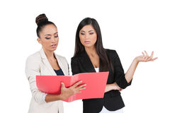 Two Indian business woman discussing documents. Royalty Free Stock Photos