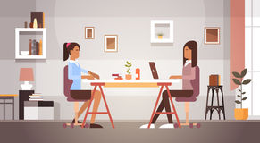 Two Indian Business Woman Sitting Desk Working Laptop Computer Businesswoman Office Royalty Free Stock Images