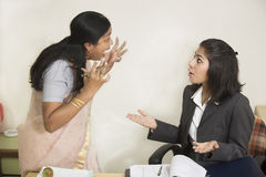 Two Indian Businesswoman fighting and screaming Stock Photography