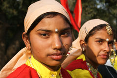 Two Indian girls in ethnic dresses. Two girls wearing ethnic dresses and jewellery (nose-ring) from Garhwal-Kumaon region in North India, during Mahabharata royalty free stock images