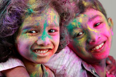 Two Indian kids with face smeared with colors. Stock Images