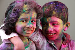 Two Indian kids with face smeared with colors. Stock Photography