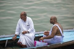 Two Indian men on boat at funeral royalty free stock photography