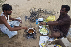 Two indian men cook local meals Stock Images