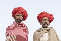 Two indian men during Pushkar Camel Mela, Rajasthan, India, close up portrait stock photography