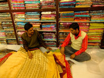 Two indian men selling testile, New Delhi Royalty Free Stock Photos