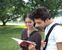 Two Indian students outside the campus. Royalty Free Stock Image