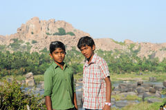 Two indian teen boys posing to the camera at Hampi. Hampi, India - 11 January 2015: Two indian teen boys posing to the camera at Hampi Royalty Free Stock Photo