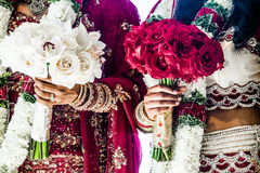 Two Indian Wedding Bouquets and brides. Red and White Traditional Indian Wedding Bouquets and brides Royalty Free Stock Images