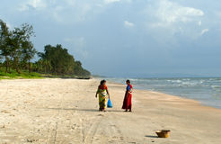 Two indian women in bright sari on the Goa beach Stock Image