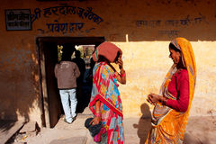 Two Indian women in sari talking outdoor Stock Image