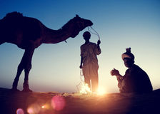 Two Indigenous Indian Men Resting Camel Concept Royalty Free Stock Images