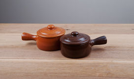 Two individual ceramic pot with lids. Stock Photography