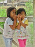 Two Indonesian Girls Whispering Stock Photo