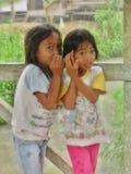 Two Indonesian Girls Whispering Stock Photo