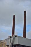 Two industrial chimneys Stock Photos