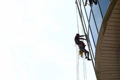 Two industrial climber wash windows business stock photo